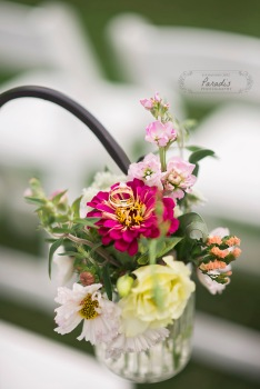 delicate wedding rings in ceremony flowers