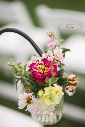 delicate wedding rings in ceremony flowers
