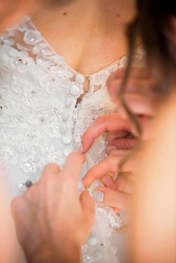 Wedding Dress Finishing Touches | Paradis Photography