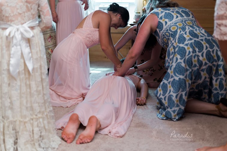 Bridesmaid's zipper | Paradis Photography | Coolidge Family Farm